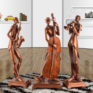 bộ 3 tượng nghệ sỹ chơi nhạc cụ.